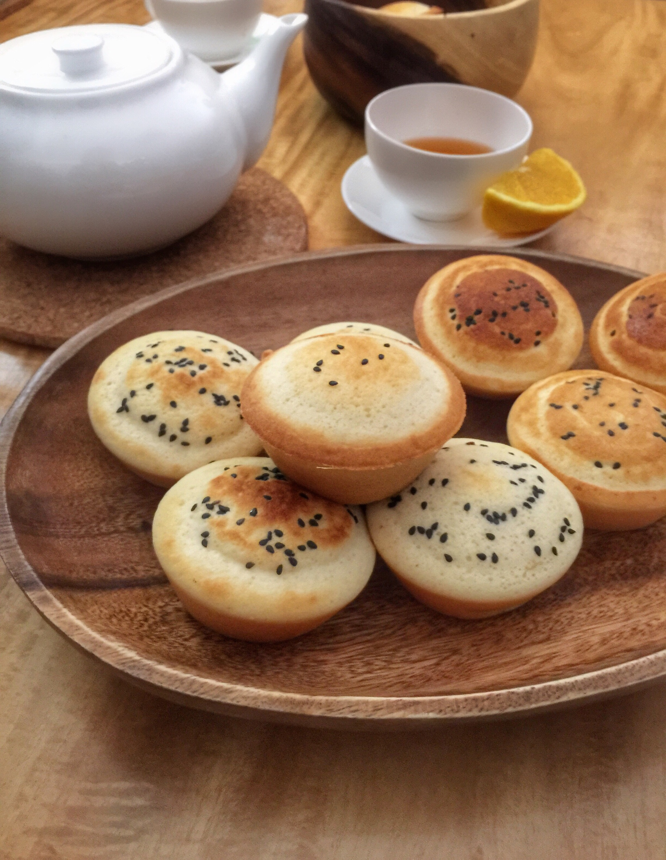 More orange mini mamons with black sesame seeds